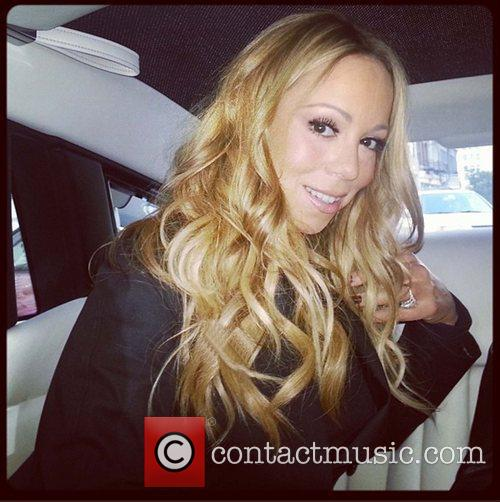 Mariah Carey tweets this pic with the caption,...
