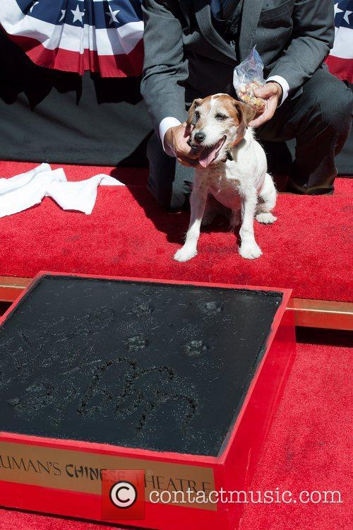 Attends the pawprint ceremony at Grauman's Chinese Theatre....