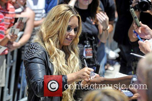 Demi Lovato signing autographs judges arrive for the...
