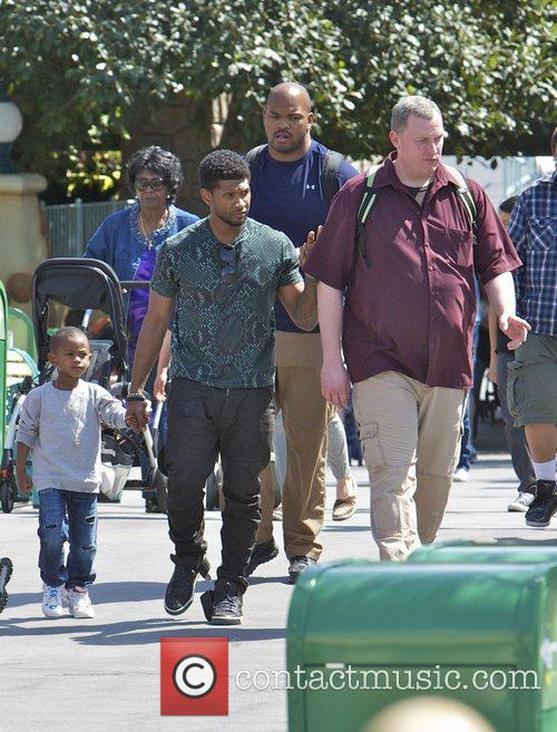 Enjoys the day at Disneyland with his family