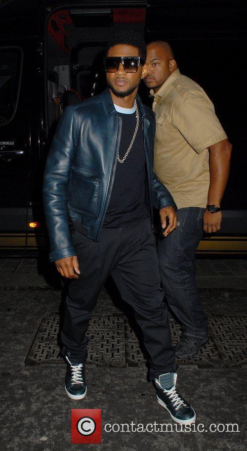 Arrives at Scott's Restaurant in Mayfair. Usher shows...