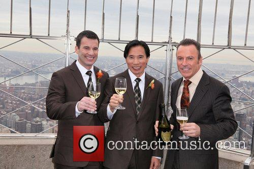Newlyweds Shawn Klein and Phil Fung pose with...