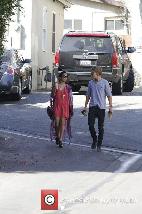 Vanessa Hudgens and a male companion out getting...