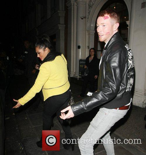 Vanessa White leaves Nobu Berkeley with a male...