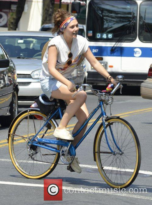 Actress Dakota Fanning and Elizabeth Olsen on the...