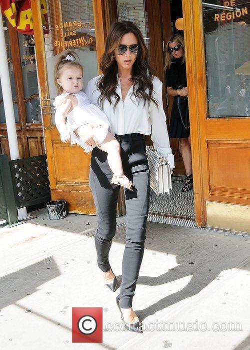 Victoria Beckham holding Harper Beckham in her arms...