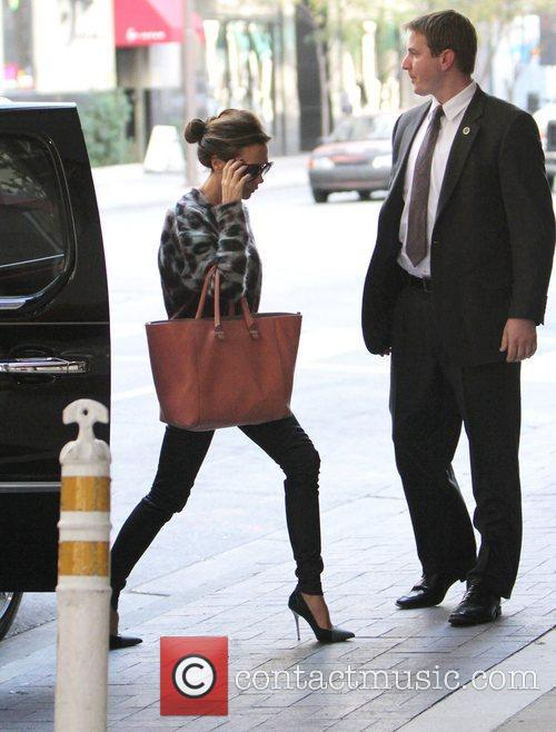 Victoria Beckham talks on her mobile phone as...