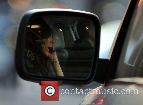 victoria beckham reflected in her cars wing 3682760