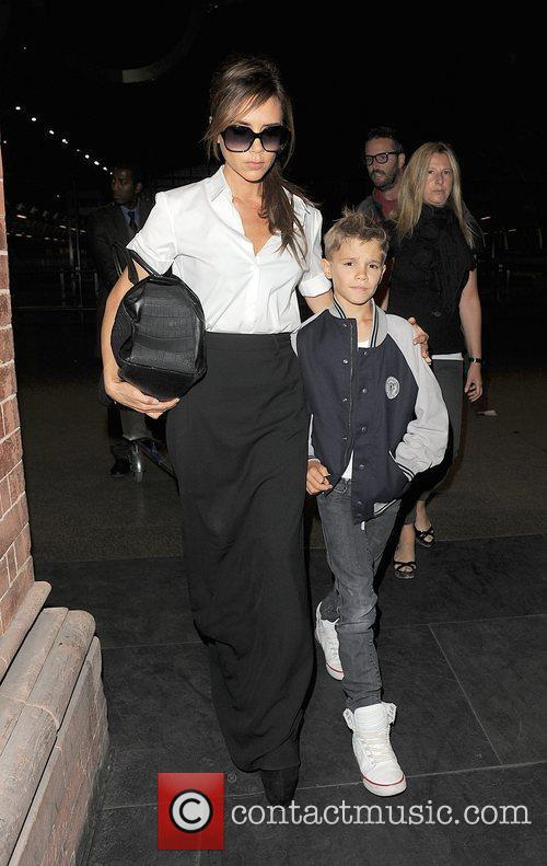 victoria beckham and romeo beckham arrive at 4003561