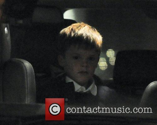 Cruz Beckham Victoria Beckham takes her children to...