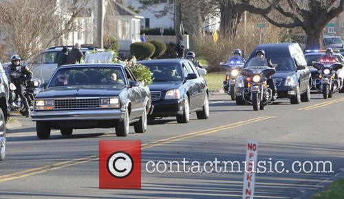 Atmosphere A hearse and family limousines for Sandy...