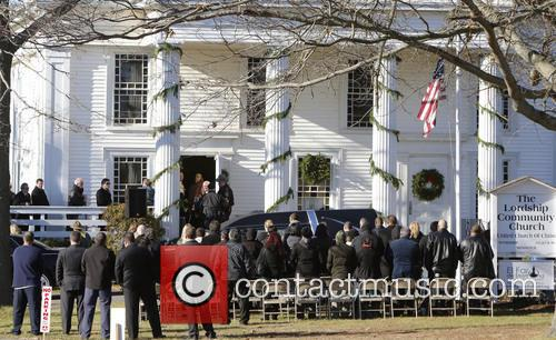 Atmosphere Mourners gather outside The Lordship Community Church...