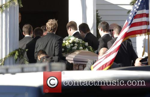 Atmosphere Pallbearers carry the casket containing the body...