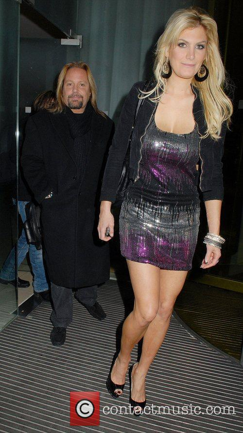 Vince Neil  leaving his hotel with a...