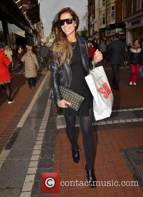 Vogue Williams shows off her engagement ring while...