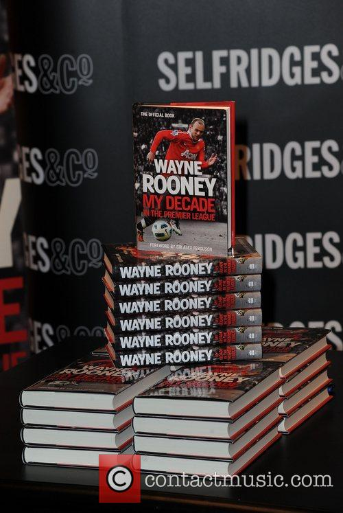 Wayne Rooney signing copies of his book 'Wayne...
