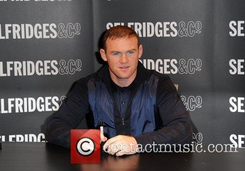 Wayne Rooney  signing copies of his book...