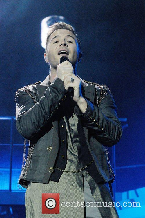 Shane Filan of Westlife performs on stage at...