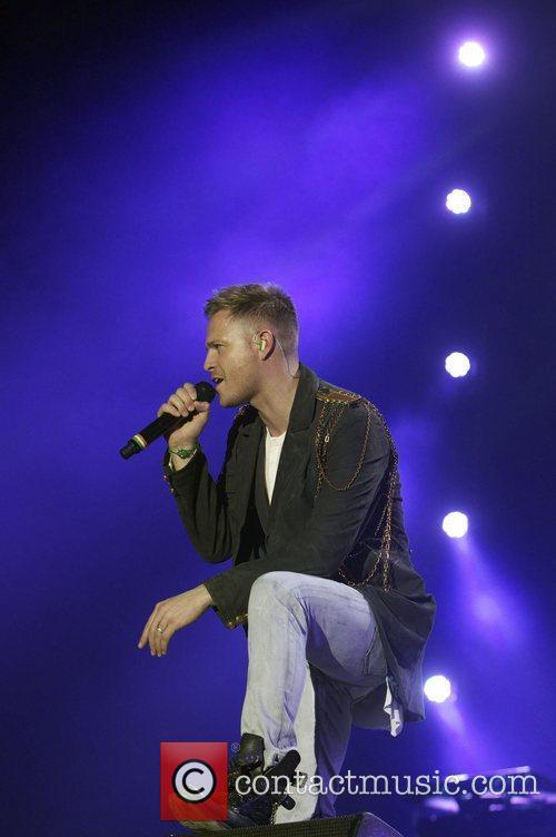 Nicky Byrne of Westlife performs live on stage...