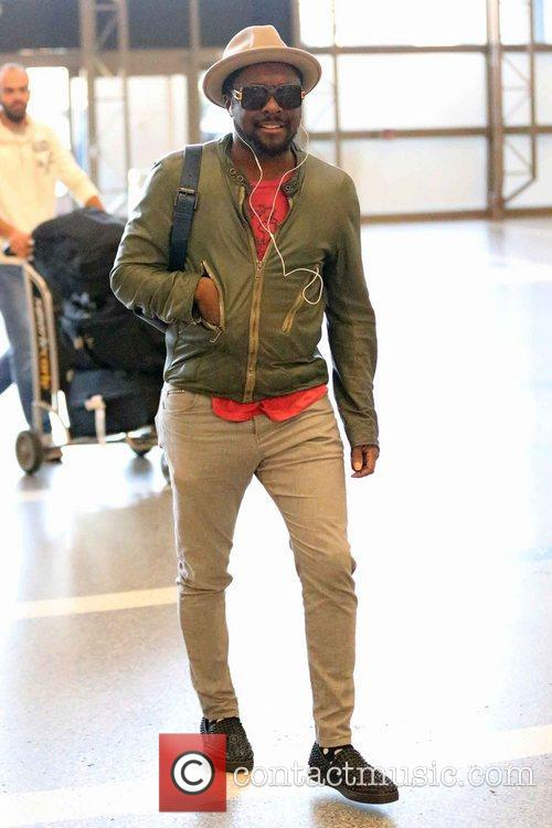 Will.i.am arrives at LAX Airport to board an...