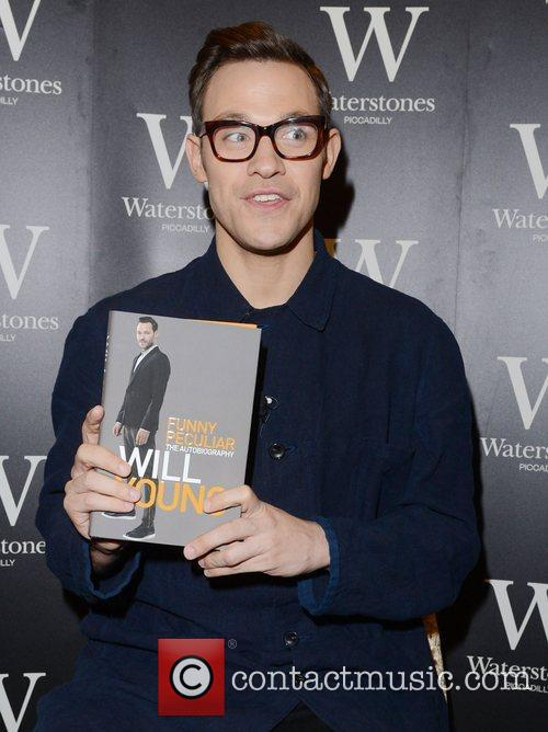 will young signs copies of his book 4146686