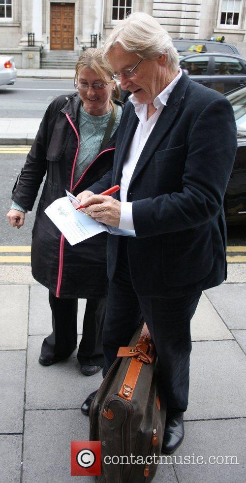 William Roache greets a fan as he arrives...