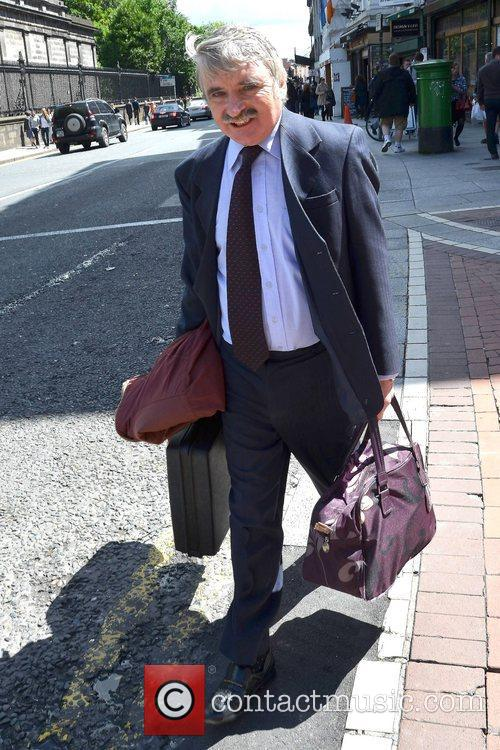 Minister Willie O'Dea is seen walking by Trinity...
