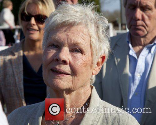 Dame Judy Dench  watches her horse run...