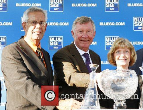 Sir Alex Ferguson  presents a trophy at...