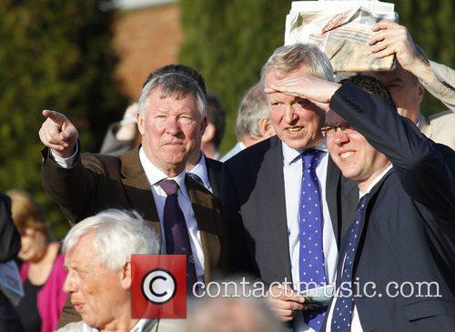 Watches his horse run at Winter Derby Day...