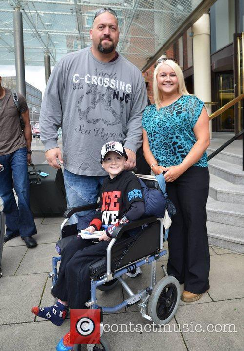 Big Show and Sarah Martin WWE wrestlers outside...