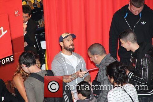 WWE Superstars attend a signing session at Virgin...