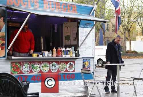 Christopher Malonet grabs breakfast from Bogi's Burger van...