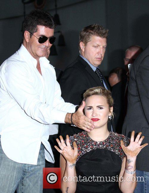 Simon Cowell, Demi Lovato and x factor 1