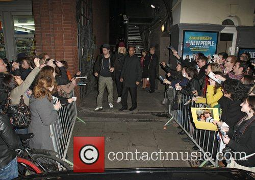 Zach Braff autographs for fans as he leaves...