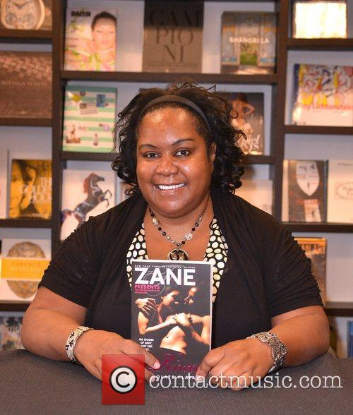 Signs copies of her new book 'Z-Rated:Chocolate Flava...