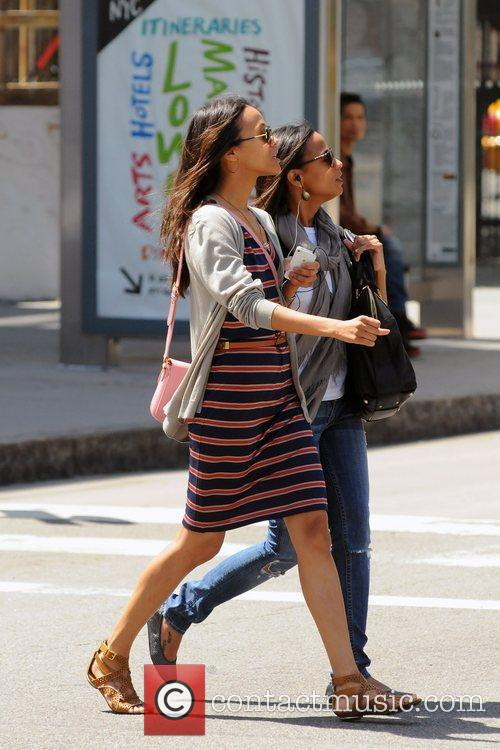 zoe saldana wearing a striped dress while 5840117