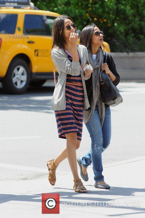 zoe saldana wearing a striped dress while 5840118