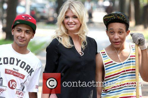 Chaz Ortiz, Kate Upton and a local volunteer...