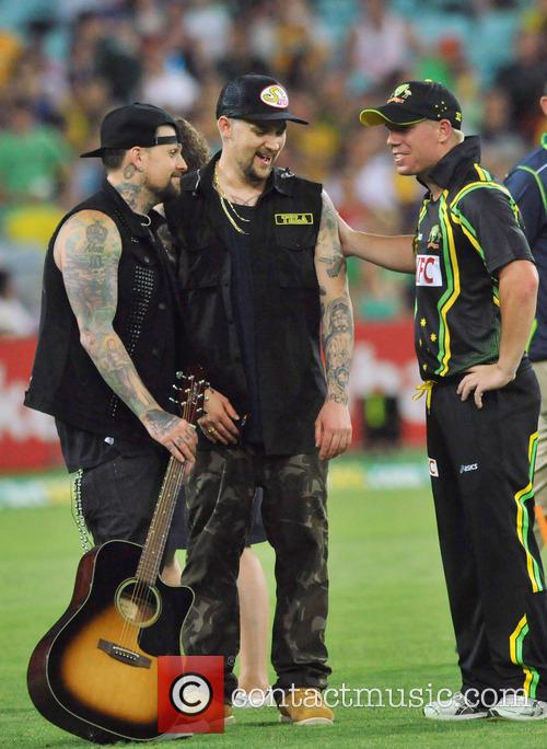 Joel Madden, Benji Madden and David Warner