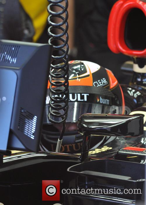 Kimi Raikkonen and The Cockpit Of His Lotus Renault F1 Car At The Australalian Gp 1