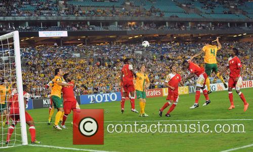 Tiim Cahill Leaps Above Oman's Abdul Sallam Al Mukhaini To Score Australia's First Goal 2