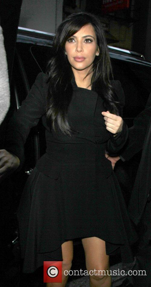 Kim Kardashian - Kim and Kourtney Kardashian arriving...