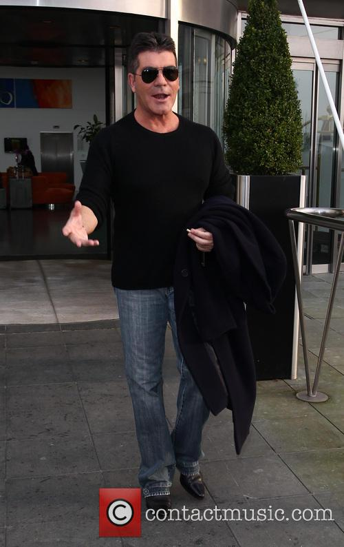 Simon Cowell - Celebrities depart their hotel ahead...