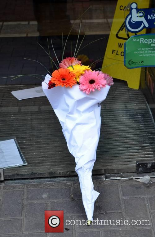 Bouquet Of Flowers Were Left In Support Of The Workers Who Lost Their Jobs 2