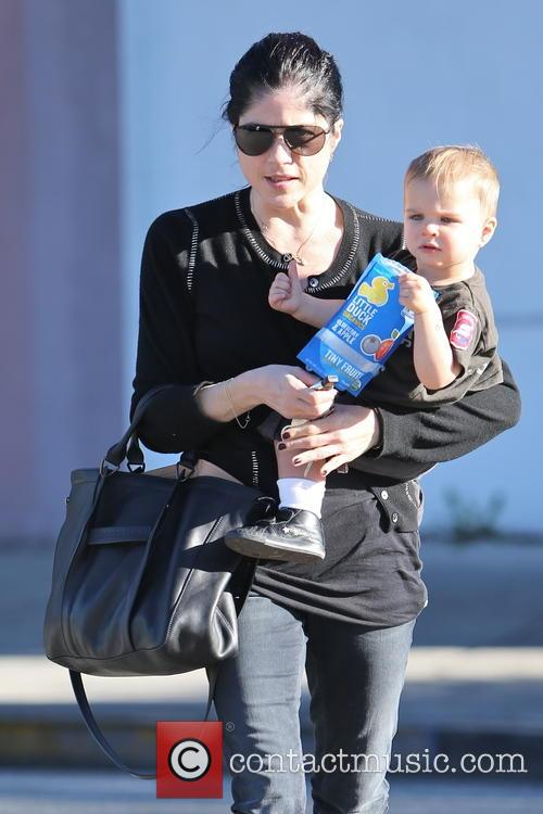 Selma Blair and  her young son Arthur Bleick exit an office building