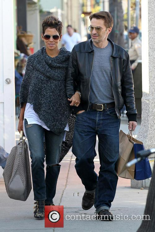Halle Berry and her beau Olivier Martinez seen...