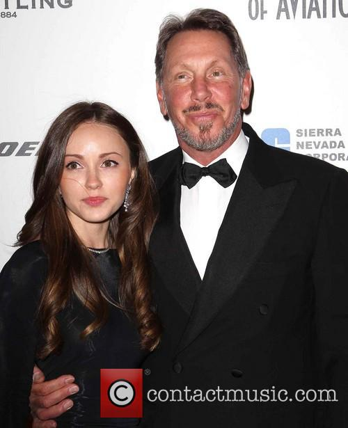 Larry Ellison and Guest 1