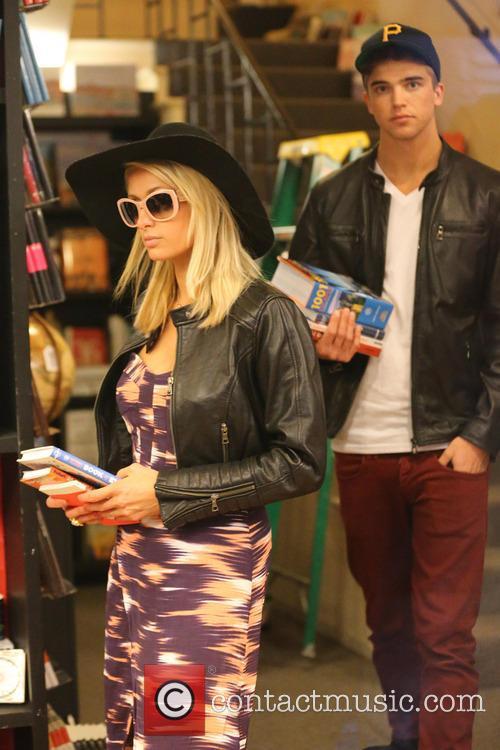 Paris Hilton and her boyfriend River Viiperi shop for books