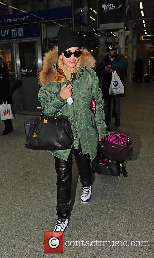 Rita Ora arrives back in London